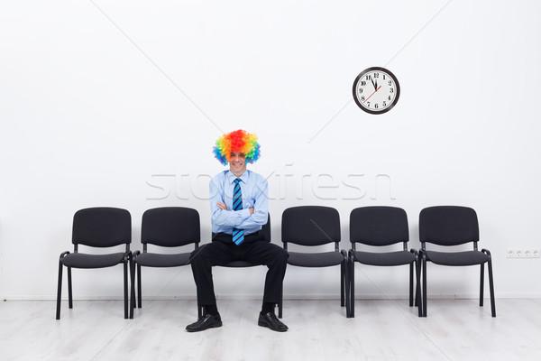 Business ungewöhnliche Geschäftsmann Clown Haar Sitzung Stock foto © lightkeeper