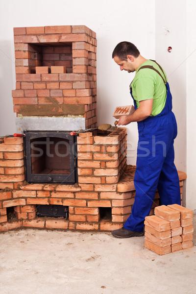 Pedreiro edifício alvenaria aquecedor vermelho tijolos Foto stock © lightkeeper