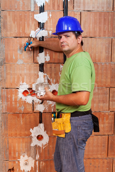 Electrician working inside new building Stock photo © lightkeeper