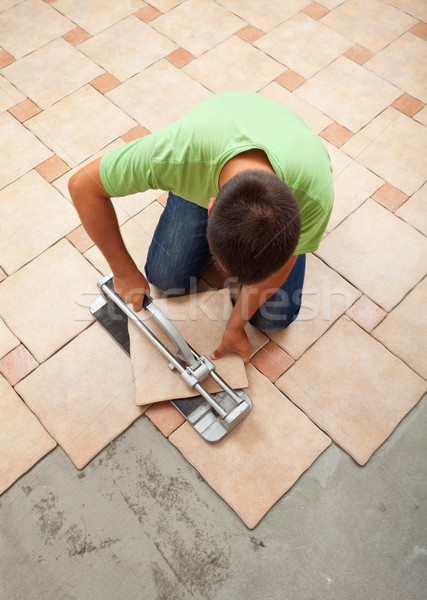 Worker cutting ceramic floor tile Stock photo © lightkeeper