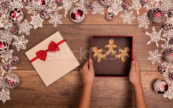 Giving or receiving gingerbread people cookies as christmas present Stock photo © lightkeeper