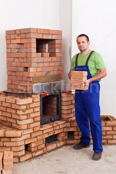 Professional worker building masonry heater Stock photo © lightkeeper