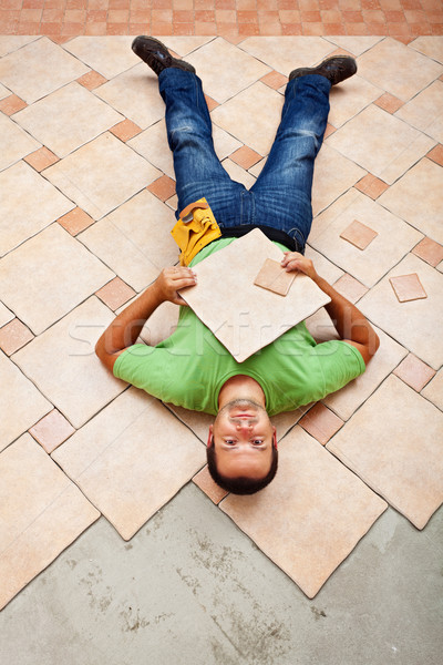 Worker resting on ceramic floor tiles Stock photo © lightkeeper