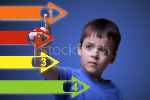 Child pointing to colorful arrows - with copy space Stock photo © lightkeeper