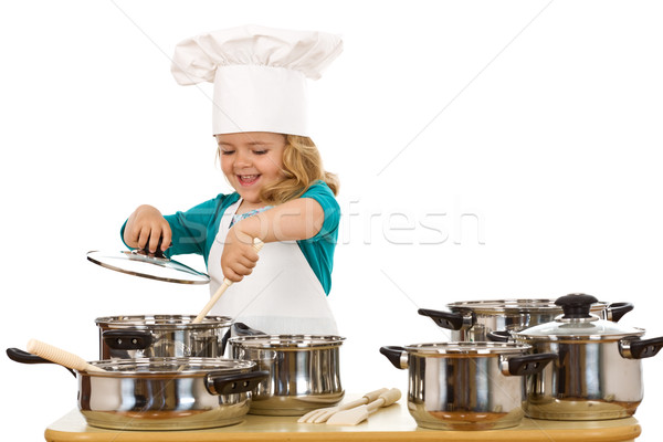 Happy chef girl stirring soup in a bowl Stock photo © lightkeeper