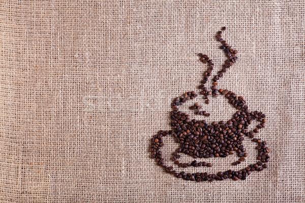 Tasse de café fèves toile de jute espace de copie fond tissu Photo stock © lightkeeper