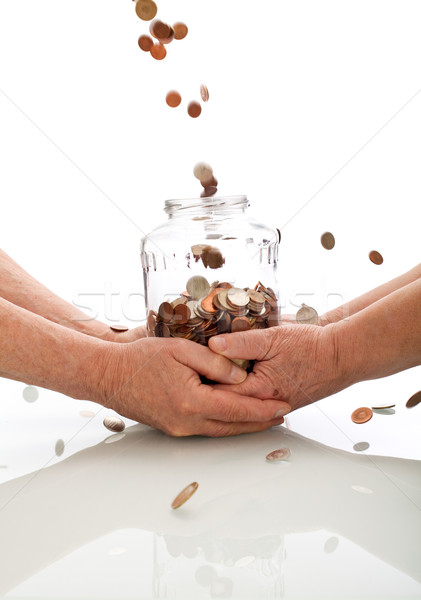 Elderly hands holding jar catching falling coins Stock photo © lightkeeper