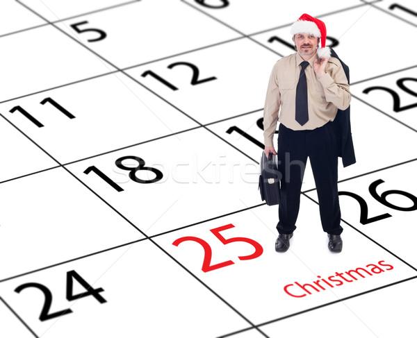 It's finally christmas - businessman standing on calendar Stock photo © lightkeeper