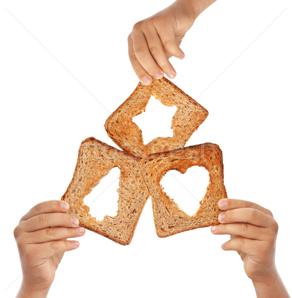 Hands holding bread with christmas symbols Stock photo © lightkeeper