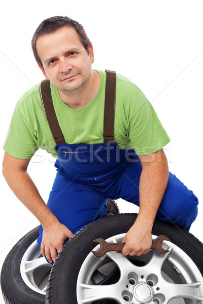 Car mechanic with tires Stock photo © lightkeeper