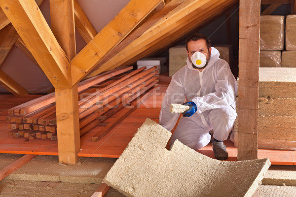 Man laying thermal insulation panels in a new house Stock photo © lightkeeper