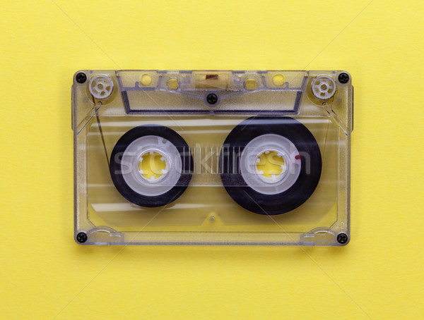 Compact audio tape cassette on yellow background Stock photo © lightkeeper