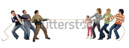 Casual man and woman playing tug of war - isolated on white Stock photo © lightkeeper