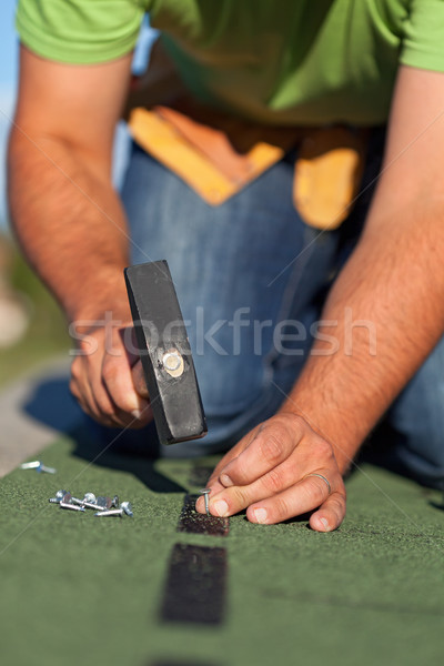 Stock photo: Fastening the bitumen roof shingles