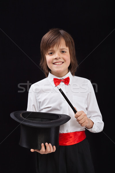 Happy magician boy on black background Stock photo © lightkeeper