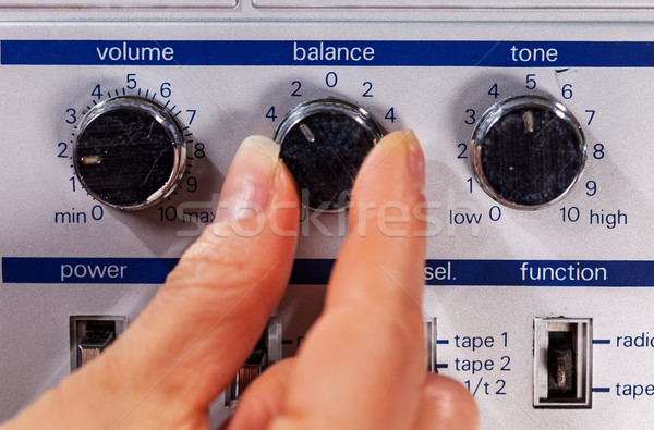 Woman hand adjusting controls of an old retro music player Stock photo © lightkeeper