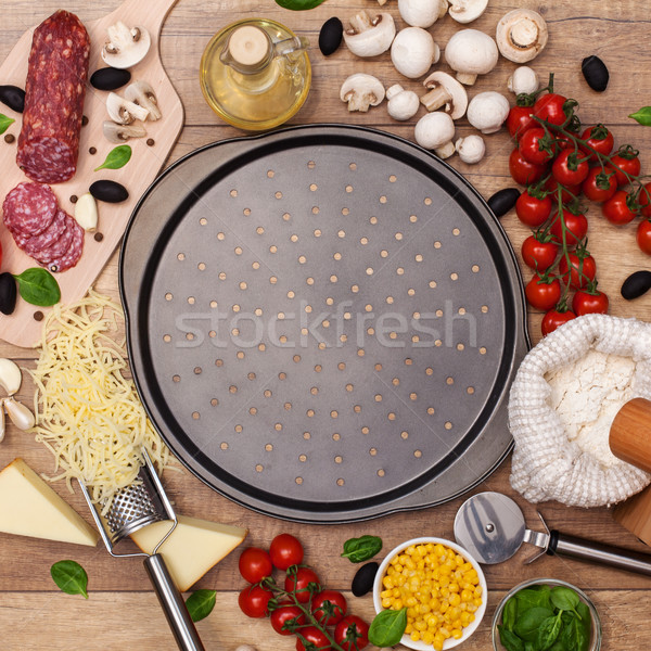 Stock photo: Ingredients around a pan ready to make a fresh homemade pizza