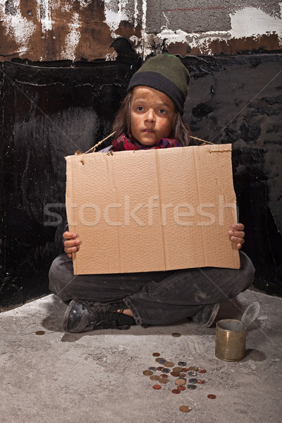 Poor beggar boy on the street with a cardboard sign Stock photo © lightkeeper