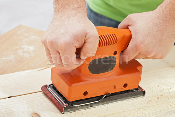 Worker hands with electric sander machine Stock photo © lightkeeper