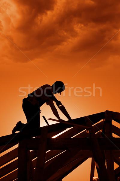 Stockfoto: Stormachtig · zonsondergang · bouwplaats · timmerman · werken · man
