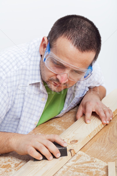 Man polishing wooden planck Stock photo © lightkeeper