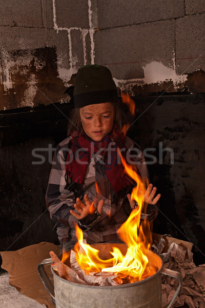 Dirty homeless boy warming at the fire Stock photo © lightkeeper