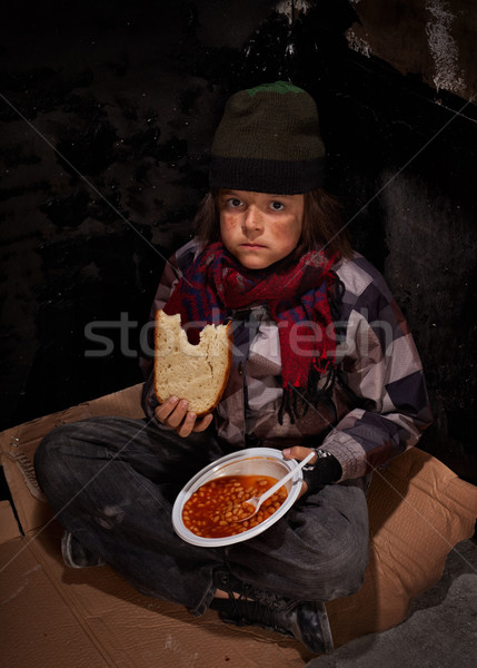 Worried young homeless boy eating charity food Stock photo © lightkeeper