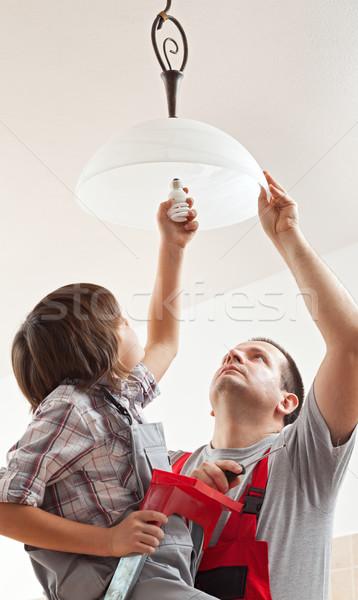 Menino ajuda pai teto lâmpada lâmpada Foto stock © lightkeeper