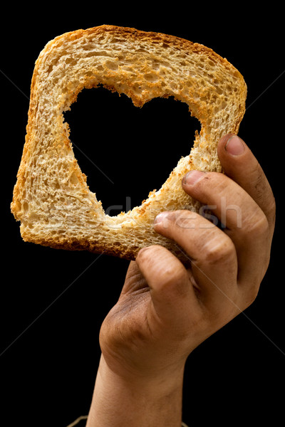 Slice of bread in child's dirty hand Stock photo © lightkeeper