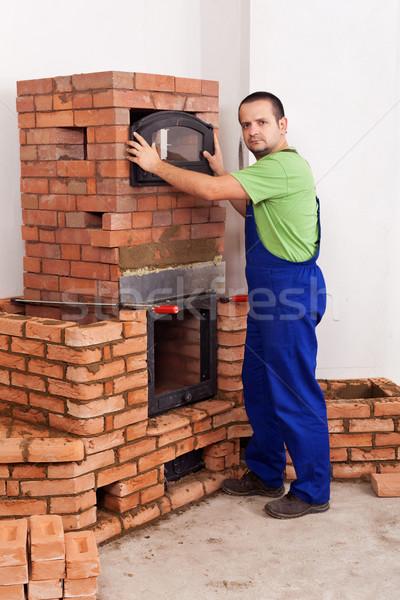 Trabalhador edifício alvenaria aquecedor vidro porta Foto stock © lightkeeper