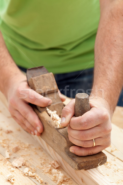 Carpenter or joiner working with plane Stock photo © lightkeeper