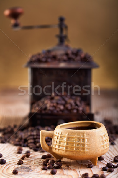 A cup of coffee and old coffee grinder Stock photo © lightkeeper