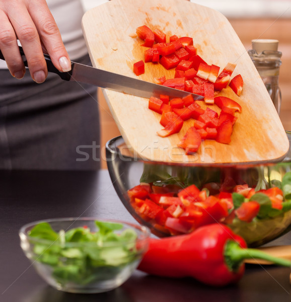 Making a vegetable salad - woman chopping red peppers Stock photo © lightkeeper