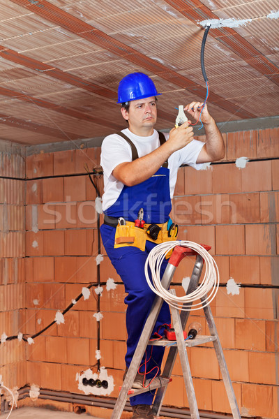 Electrician working on ceiling wires Stock photo © lightkeeper