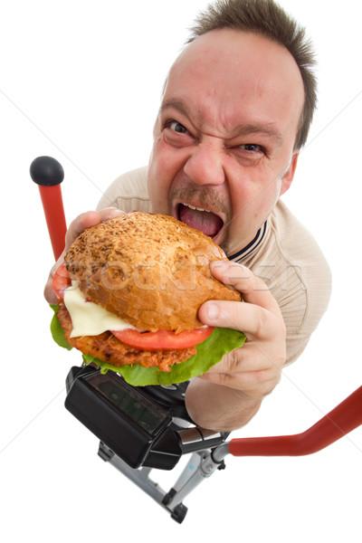 Hölle Mann Essen groß Hamburger Ausbilder Stock foto © lightkeeper