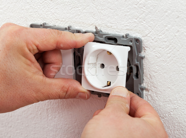 Installing electrical outlet or socket - closeup Stock photo © lightkeeper