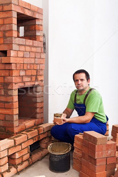 Homme bâtiment maçonnerie chauffage argile Photo stock © lightkeeper