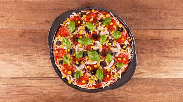 Pizza előkészített sütés felső kilátás asztal Stock fotó © lightkeeper