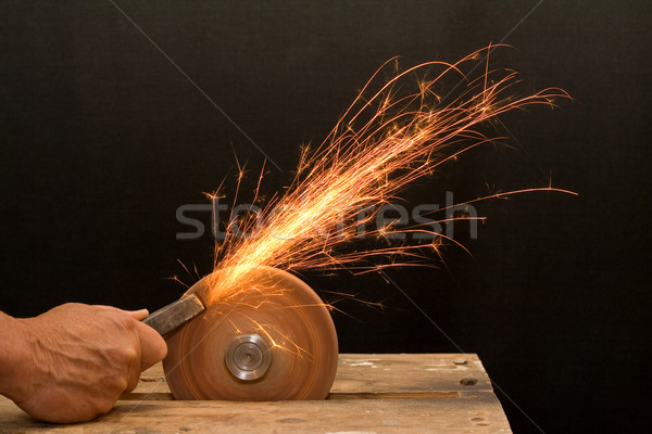Senior craftsman hand grinding Stock photo © lightkeeper