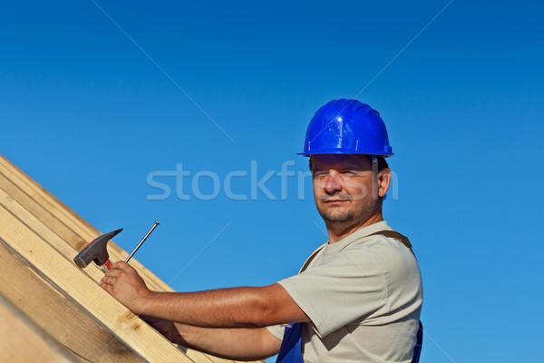 誇りに思う 建設作業員 屋根 構造 爪 ハンマー ストックフォト © lightkeeper