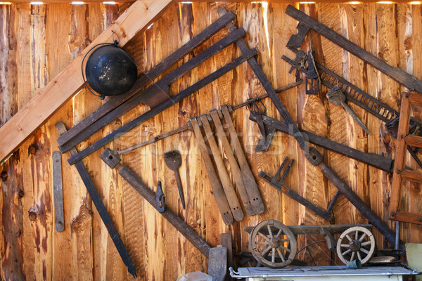 Old tools in wood shed Stock photo © lightkeeper