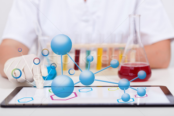 Conducting chemical experiments and documenting it on tablet com Stock photo © lightkeeper