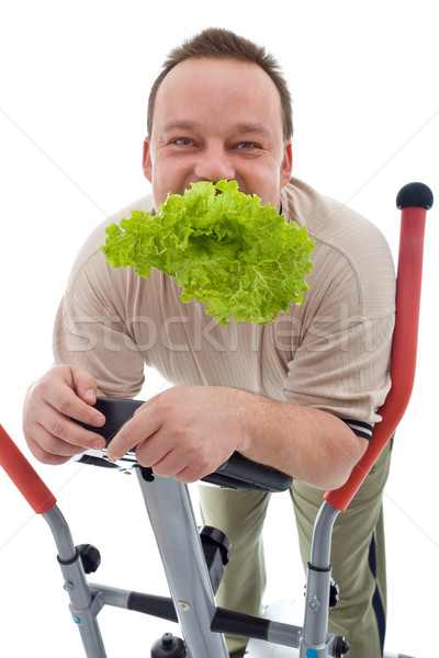 Power slimming concept - man exercising and eating healthy Stock photo © lightkeeper
