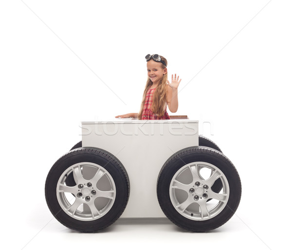 Travel concept with little girl and wheeled box Stock photo © lightkeeper