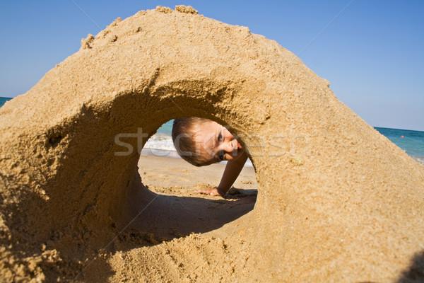 Fiú néz homokvár tengerpart szórakozás gyermek Stock fotó © lightkeeper
