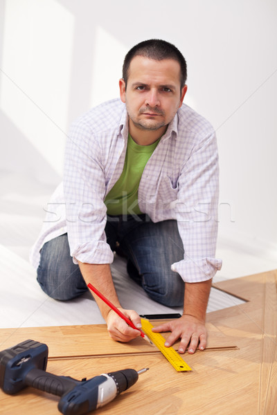 Home improvement - laying laminate flooring Stock photo © lightkeeper