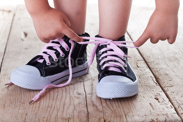 Child successfully ties shoes Stock photo © lightkeeper