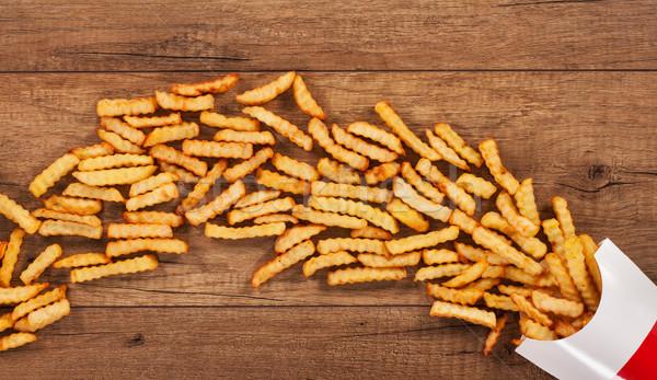 Papírzacskó sültkrumpli folyam barna asztal copy space Stock fotó © lightkeeper