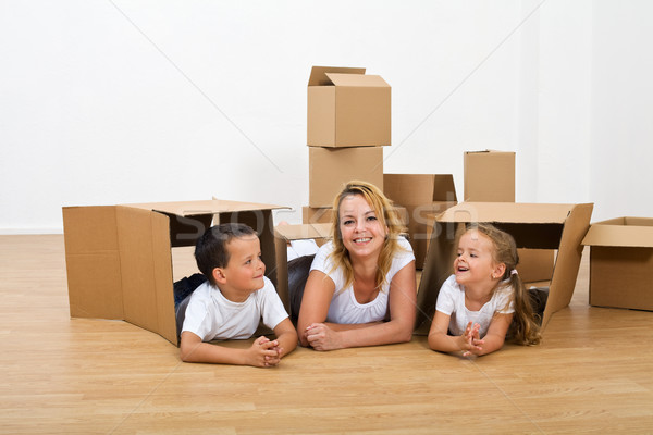 Happy woman and kids relaxing in their new home Stock photo © lightkeeper