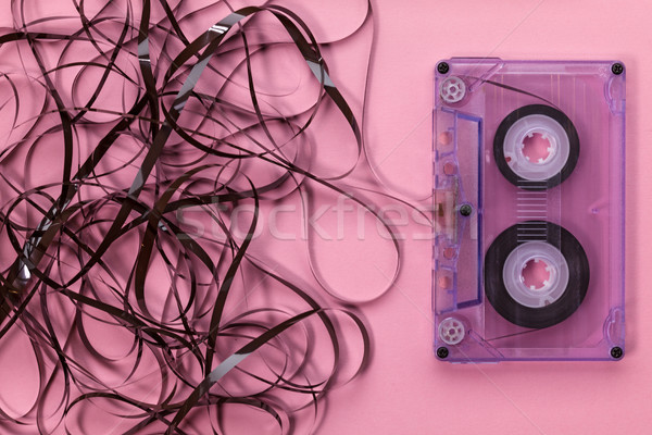 Compact audio cassette on pink background with the tangled tape  Stock photo © lightkeeper